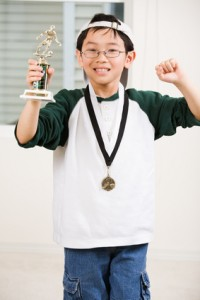 Should your child get a trophy for sitting the bench?