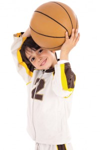 Little kid while throwing the basketball