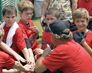 CUMMING, GA,USA - MAY 15:  A coach giving a pep talk to his baseball team of 10-11 year old boys, Bulldogs vs Broncos,  May 5, 2010, Forsyth County, Cumming GA.